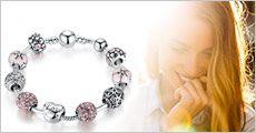 Sterling sølv-armbånd med 9 charms fra Modane.dk, værdi kr. 519,-